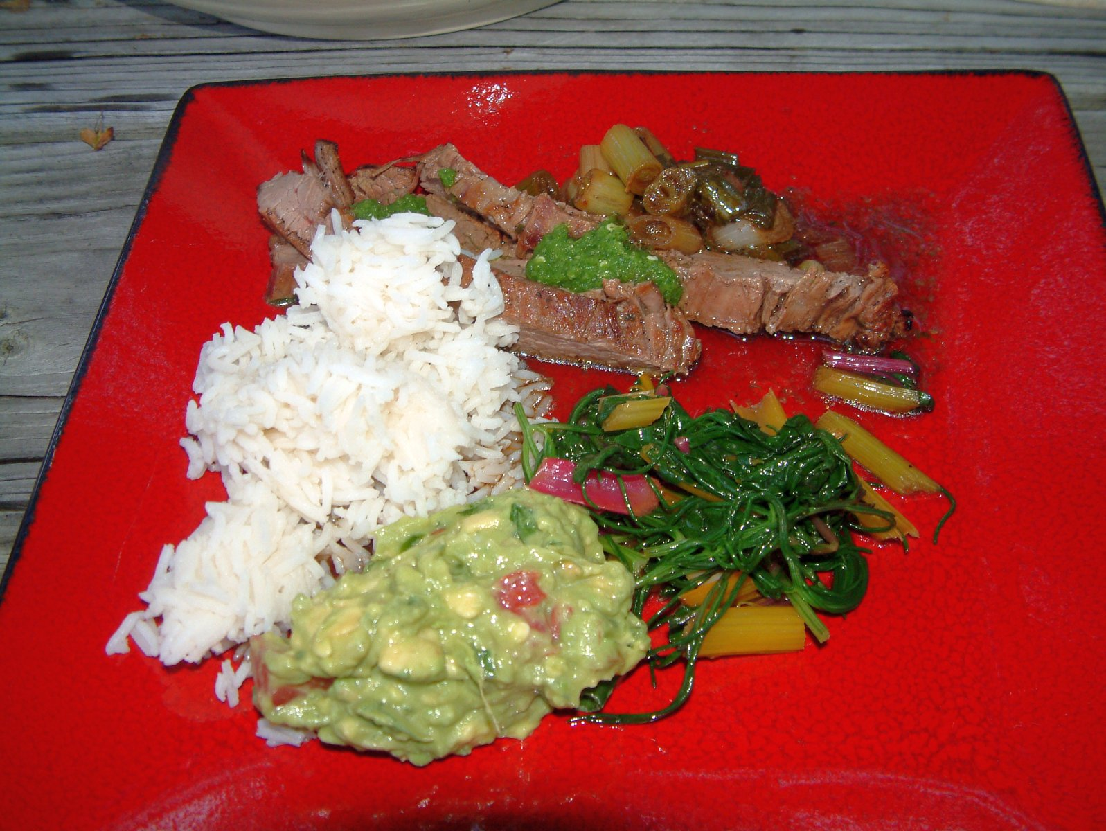 Grilled Beef Shank, Rice, Guacamole, Sauteed Swiss Chard and Chimichurri